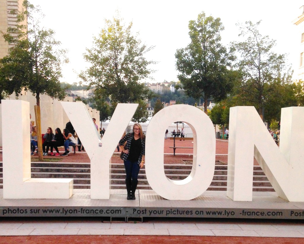 Alexis Lian with Lyon sign