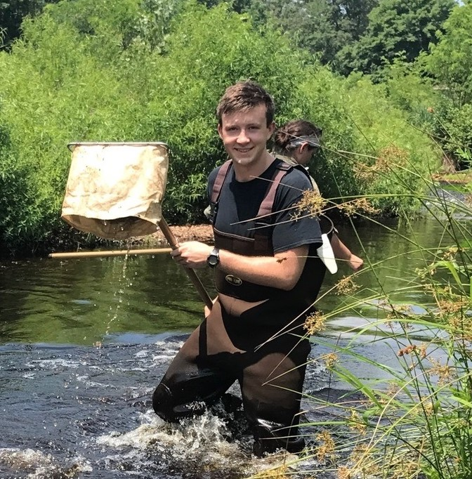 Picture of Hamish collecting samples